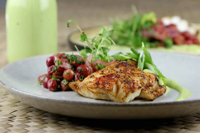 seasoned grilled fish with cherry salad