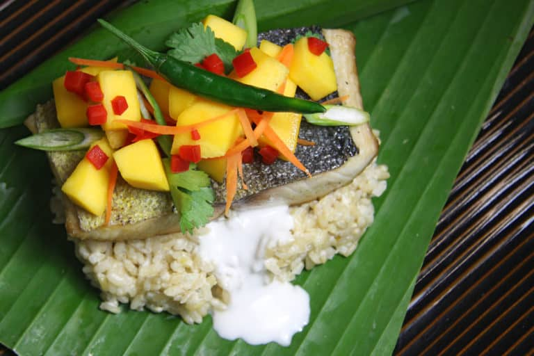 fish over coconut rice with mango salasa