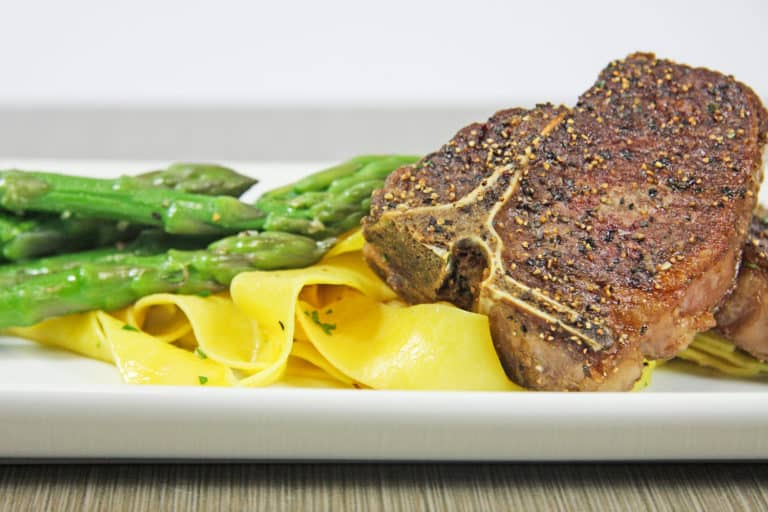 pork chops with egg noodles and fresh asparagus, college sports nutrition options